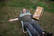 Polish man age 58 enjoying a well deserved rest on a lawn chair. Zawady Central Poland