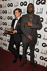 Left to right, Tanqueray Most Stylish Man award winner MATT SMITH and IDRIS ELBA at the GQ Men of the Year 2011 Awards dinner held at The Royal Opera House, Covent Garden, London on 6th September 2011.