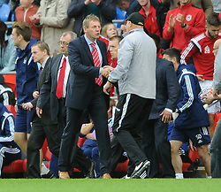 Nottingham Forest Manager, Stuart Pearce and Cardiff City Manager, Russell Slade shake hands at the end of the game - Photo mandatory by-line: Dougie Allward/JMP - Mobile: 07966 386802 - 18/10/2014 - SPORT - Football - Cardiff - Cardiff City Stadium - Cardiff City v Nottingham Forest - Sky Bet Championship