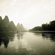 Local fishing by the Karst Limestone Mountains on the Li River, Guilin, Guangxi Province, China.