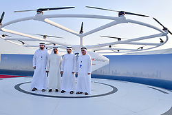 Dubai Crown Prince Sheikh Hamdan bin Mohammed Al Maktoum (2nd from R), attends presentation and first flight of the Volocopter 2X used as Autonomous Air Taxi, in Dubai, United Arab Emirates, on September 25, 2017. It is a drone that will be the world's first self-flying taxi service set to be introduced by Dubai's Road and Transport Authority (RTA), in the coming years. The two-seater vehicle, is capable of transporting people without human intervention or a pilot, and is supplied by Volocopter, a Germany-based specialist manufacturer of autonomous air vehicles. Photo by Balkis Press/ABACAPRESS.COM