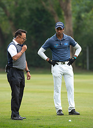 November 24, 2018 - Hong Kong, Hong Kong SAR, CHINA - Honma Hong Kong Open Golf 2018 at Hong Kong Golf Club Fanling. Rai discusses his ball position with a marshall on the 11th fairway.Englishman Aaron Rai holds onto his clear lead in day 3 of the tournament. After breaking the course record in the last round Rai remains steady and clear of Englands Matthew Fitzpatrick and South Koreas Hyowon Park. (Credit Image: © Jayne Russell/ZUMA Wire)