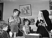 14/05/1959<br /> 05/14/1959<br /> 14 May 1959<br /> School for the Deaf at Mary Immaculate School for the deaf, Beech Park, Stillorgan. Sr. Mary Benignus (Daughters of the Cross) helps Eamon O'Connor (3), John Doyle (5), and Gerard O'Grady (5) in an auditory lesson using modern methods.