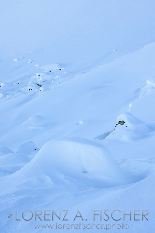 A fresh snow-covered landscape on the way up to Piz Lagrev, Julier Pass, Grisons, Switzerland