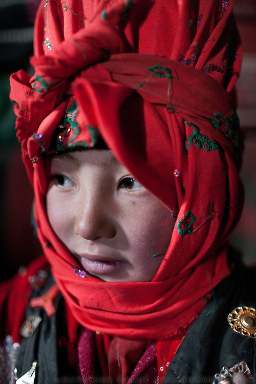 Portrait of a young Kyrgyz girl..In and around Ech Keli, Er Ali Boi's camp, one of the richest Kyrgyz in the Little Pamir...Trekking with yak caravan through the Little Pamir where the Afghan Kyrgyz community live all year, on the borders of China, Tajikistan and Pakistan.