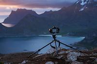 Camera and tripod on mountain peak, Vestvågøy, Lofoten Islands, Norway