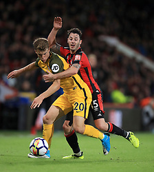 Brighton & Hove Albion's Solly March (left) and AFC Bournemouth's Adam Smith battle for the ball during the Premier League match at the Vitality Stadium, Bournemouth.
