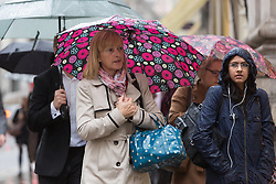 © Licensed to London News Pictures. 28/10/2015. London, UK. Commuters walking near Bank in the City of London on their way to work across London Bridge during heavy rain and wet weather this morning. Photo credit : Vickie Flores/LNP