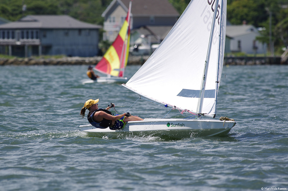 Youth sailor Ashlyn Park passes and leads defending champion Sonya Dean in the last leg of the round-the-island race at the Harkers Island Regatta.
