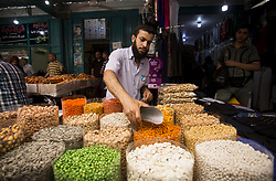 June 14, 2018 - Gaza City, The Gaza Strip, Palestine - Palestinians shop in a market before the holiday of Eid al-Fitr in the Jabalia camp the northern Gaza Strip. Eid al-Fitr is the end of Ramadan for Muslims when believers refrain from eating, drinking, smoking and sexual activities from dawn until dusk. (Credit Image: © Mahmoud Issa/Quds Net News via ZUMA Wire)