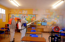 South Africa - Cape Town - 23 June 2020 - Covid -19 Disinfect Now in parnership with Khayelitsha Development Forum disinfecting Yomelela Primary School. The Covid 19 Disinfect now group embark on a pilot programme to disinfect community of site b starting with school ensuring the slowdown of transmission of this virus. The machinery utilised for this purpose is a Cannon FC 25 which can disperse disinfectant up to a range of 2500 meters depending on the South easter or wind speed across 365 Deg. The cannon capabilities ensures that   it can penetrate through the clusters schools, taxi ranks and other public spaces.Photographer Ayanda Ndamane African News Agency(ANA)