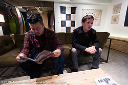 Harley-Davidson designers Dais Nagao (L) and Ben McGinley at the Deus Ex Machina new Tokyo store 3-days after its grand opening. Tokyo. Japan. Wednesday, December 10, 2014. Photograph ©2014 Michael Lichter.