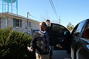 Rev. Cherian Thalakulam blessing a car. Two travellers are going all the way to California to sell some industrial equipment.<br /> <br /> Murphy Village, North Augusta, South Carolina is a community of around 2000 Irish Travellers who settled there in the late 60s. They bought some land, following the advice of Catholic priest Father Murphy who also had a catholic church, St Edward, built in Murphy village.
