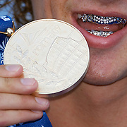 Ryan Lochte of USA displays his medal to the media photographers after receiving the Gold medal for the Men's 400m IM at the World Swimming Championships in Rome, Italy on Sunday, August 2, 2009. Photo Tim Clayton..