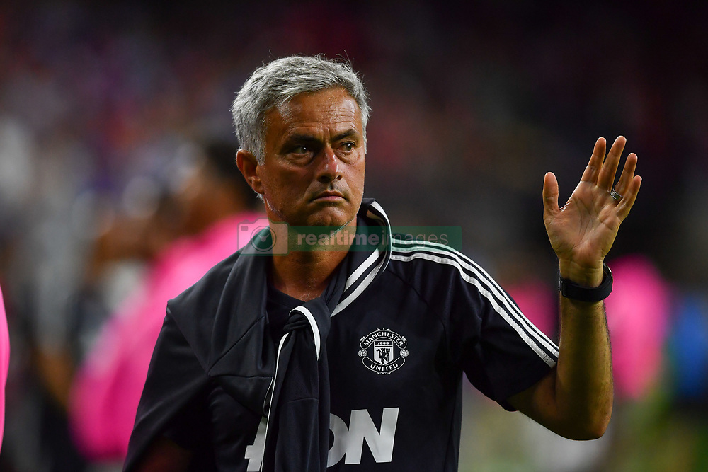 Manchester United head coach Jose Mourinho waves to fans at the International Champions Cup match between Manchester United and Manchester City at NRG Stadium in Houston, Texas