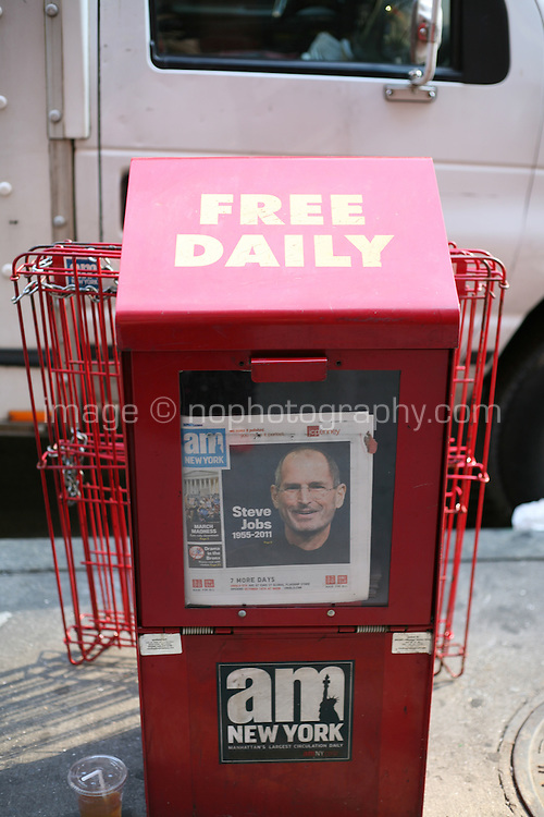 Newspaper vending machine with the AM New York showing the headline Steve Jobs 1955 - 2011