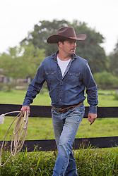 portrait of a handsome cowboy outdoors