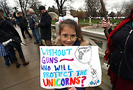 BOULDER, CO - APRIL 21: Paisley Hollywood, 10, wearing a unicorn horn holds a sign at a pro gun rally on April 21, 2018 in Boulder, Colorado. The city of Boulder is considering enacting an ordinance that will ban the sale and possession of assault weapons in the city. (Photo by Rick T. Wilking/Getty Images)