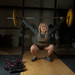 Jaelyn Wolf does an Overhead Squat with a weightvest from www.weightvest.com. Crossfit image, picture, photo, photography of health, elite, exercise, training, workouts, WODs, taken at Progressive Fitness CrossFit,Colorado Springs, Colorado, USA
