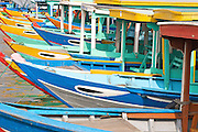 Colorful boats docked on the waterfront in central Hoi An, Vietnam.