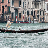 VENICE, ITALY - FEBRUARY 19:  A gondolier dressed with 1700 costumes crosses the Grand Canal (Canal Grande) on February 19, 2012 in Venice, Italy.  The annual festival, which lasts nearly three weeks, will see the streets and canals of Venice filled with people wearing highly-decorative and imaginative carnival costumes and masks.  (Photo by Marco Secchi/Getty Images)
