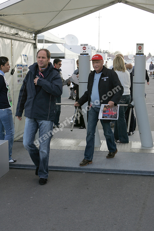 Gerhard Berger and Nki Lauda entering the paddock before qualifying for the 2006 European Grand Prix at the Nurburgring. Photo: Grand Prix Photo