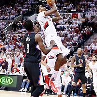 25 April 2016: Portland Trail Blazers forward Al-Farouq Aminu (8) goes for the layup past Los Angeles Clippers forward Jeff Green (8) during the Portland Trail Blazers 98-84 victory over the Los Angeles Clippers, during Game Four of the Western Conference Quarterfinals of the NBA Playoffs at the Moda Center, Portland, Oregon, USA.