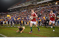 11 June 2013; British & Irish Lions captain Brian O'Driscoll and team-mate Jamie Roberts lead their side out ahead of the game. British & Irish Lions Tour 2013, Combined Country v British & Irish Lions, Hunter Stadium, Newcastle, NSW, Australia. Picture credit: Stephen McCarthy / SPORTSFILE