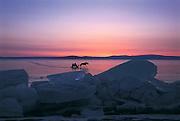 Horse sleds on frozen lake<br /> Lake Hovsgol<br /> Northern Mongolia