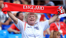 An England fan waves a scarf during the FIFA World Cup Group G match at the Nizhny Novgorod Stadium.