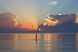 man on a paddle board at sunrise in Fort Lauderdale, Florida
