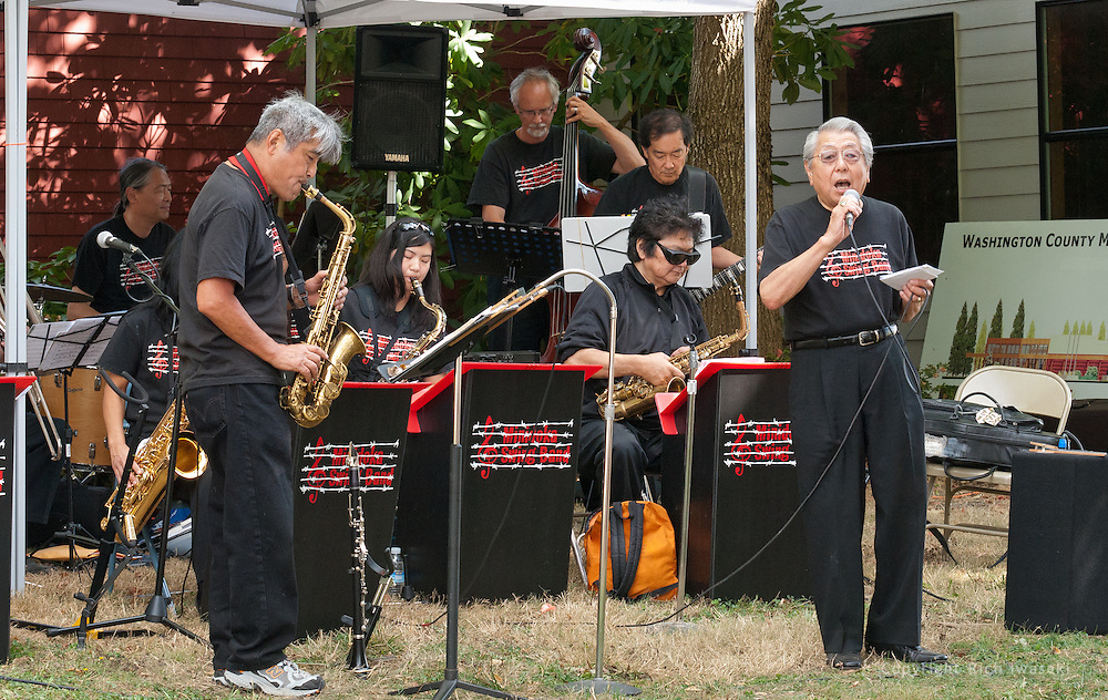 """Vocalist Henry """"Shig"""" Sakamoto (right) performs with The Minidoka Swing Band on the grounds of Washington Country Museum, Hillsboro, Oregon"""