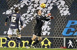 Millwall's Stephen Bywater fumbles the ball but Sheffield Wednesday can't score - Photo mandatory by-line: Robin White/JMP - Tel: Mobile: 07966 386802 28/01/2014 - SPORT - FOOTBALL - The Den - Millwall - Millwall v Sheffield Wednesday - Sky Bet Championship