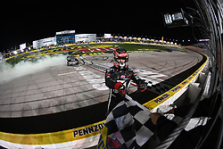 March 1, 2019 - Las Vegas, NV, U.S. - LAS VEGAS, NV - MARCH 01: Kyle Busch (51) KBM Toyota Tundra is given the Sunoco checkered flag while celebrating the race win during the NASCAR Gander Outdoors Truck Series Strat 200 on March 01, 2019, at Las Vegas Motor Speedway in Las Vegas, NV. (Photo by Chris Williams/Icon Sportswire) (Credit Image: © Chris Williams/Icon SMI via ZUMA Press)