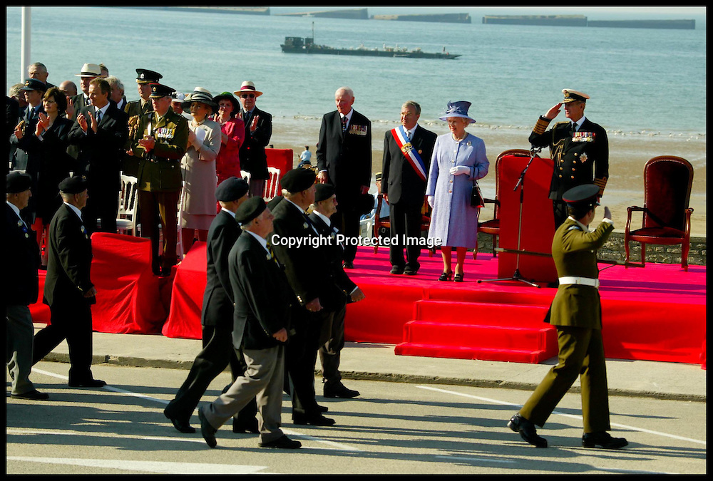 HRH The Queen Takes the Salute from the D-day Veterans in the Square in Arromanches Today Sunday 6th June 2004 to mark the 60th Anniversery of D-DAY.PA Photo Andrew Parsons