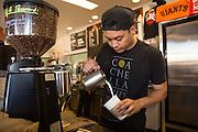 Randolph Viray, 27, of San Jose creates latte art at Roy's Station Coffee & Teas in Japantown of San Jose, California, on September 16, 2014. (Stan Olszewski/SOSKIphoto for Content Magazine)