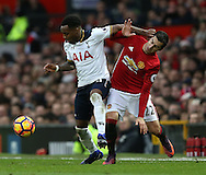 Danny Rose of Tottenham tussles with Henrikh Mkhitaryan of Manchester United during the English Premier League match at Old Trafford Stadium, Manchester. Picture date: December 11th, 2016. Pic Simon Bellis/Sportimage