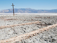 Ruins of wooden structures once used in salt mining at Salt Lake in Saline Valley, Death Valley National Park, California