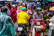 13 October, 2020, Hoi an: After a storm the market is as busy as ever as the rain came down lightly.
