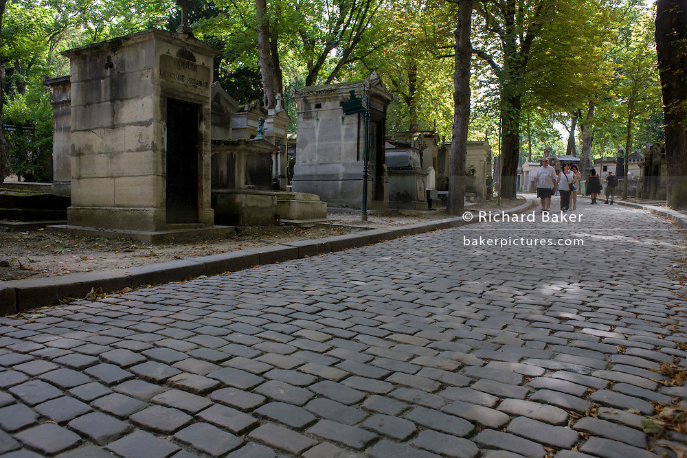 Wide cobbled avenue in the Pere Lachaise cemetery, Paris. Père Lachaise Cemetery (Cimetière du Père-Lachaise) is the largest cemetery in the city of Paris, France (44 hectares (110 acres) though there are larger cemeteries in the city's suburbs. Père Lachaise is in the 20th arrondissement, and is reputed to be the world's most visited cemetery, attracting hundreds of thousands of visitors annually to the graves of those who have enhanced French life over the past 200 years. It is also the site of three World War I memorials.