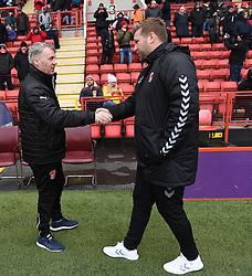 Charlton Athletic manager Karl Robinson (left) and Fleetwood Town manager John Sheridan shake hands before kick off