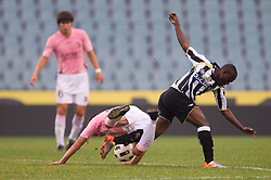 Emmanuel Agyemang Badu of Udinese (R) vs Armin Bacinovic of Palermo during football match between Udinese Calcio and Palermo in 8th Round of Italian Seria A league, on October 24, 2010 at Stadium Friuli, Udine, Italy.  Udinese defeated Palermo 2 - 1. (Photo By Vid Ponikvar / Sportida.com)