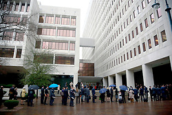 25 February 2013. New Orleans, Louisiana,  USA. .Lawyers and journalists line up in the early morning drizzle for the opening day of the BP trail  at the New Orleans Federal Courthouse..Photo; Charlie Varley.