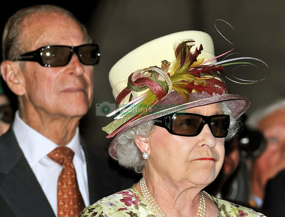 Queen Elizabeth II and the Duke of Edinburgh wear 3D glasses to watch a 3D film, at the Pinewood Studios in Toronto, Canada.