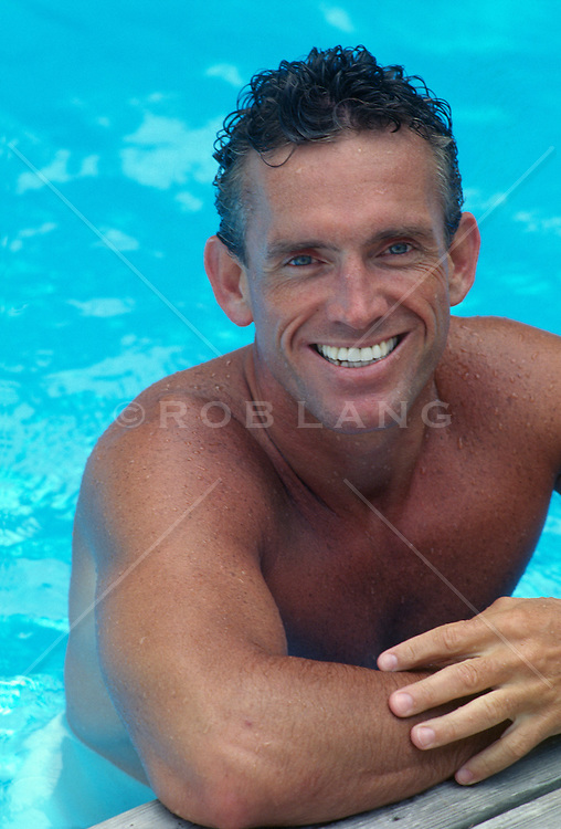 Portrait of a good looking man in a swimming pool