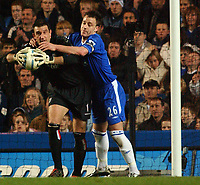 Photo: Daniel Hambury, Digitalsport<br /> Chelsea v West Bromwich Albion.<br /> FA Barclays Premiership.<br /> 15/03/2005.<br /> Chelsea's John Terry gerts to grips with  West Brom's Russell Hoult