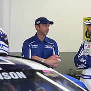 Crew chief Chad Knaus and driver Jimmie Johnson talk in the garage area during the 56th Annual NASCAR Daytona 500 practice session at Daytona International Speedway on Saturday, February 22, 2014 in Daytona Beach, Florida.  (AP Photo/Alex Menendez)