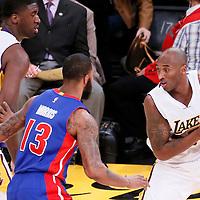 15 November 2015: Detroit Pistons forward Marcus Morris (13) defends on Los Angeles Lakers forward Kobe Bryant (24) next to Los Angeles Lakers center Roy Hibbert (17) during the Los Angeles Lakers 97-85 victory over the Detroit Pistons, at the Staples Center, Los Angeles, California, USA.