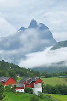 Mountain rising above farm building in the Romsdal Valley near Åndalsnes, Norway