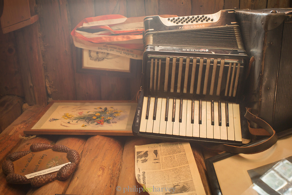 Close-up of decorations, paintings, accordion in Berghof Lodge in Bariloche, Argentina